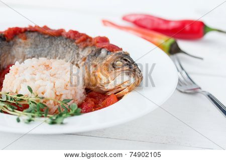 Steamed Sea Bass In Tomato Sauce With Chili Pepper.