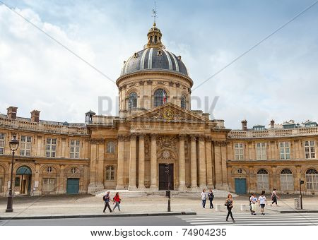 Tourists Walking Near The Institute De France In Paris