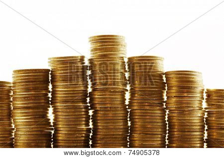 Seven piles of gold coins on a white background