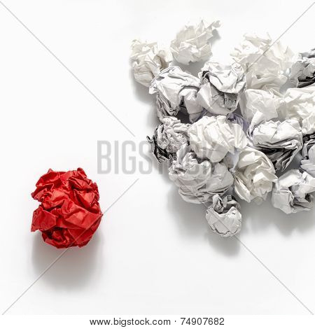 White Crumpled Paper Ball And Different Red Crumpled Paper Ball