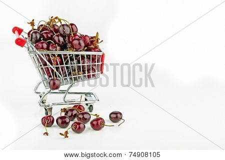 Fresh cherries in a supermarket cart