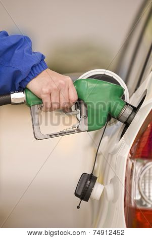 Refueling Automobile With Nozzle of Gasoline Pump