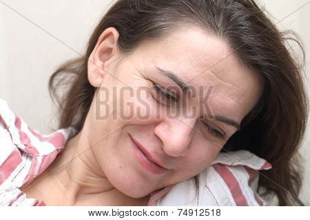 Woman In Her 40 S Looking Down Smiling