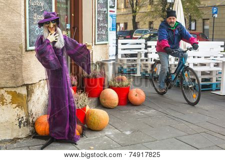 KRAKOW, POLAND - OCT 29, 2014: Unidentified townspeople and scenery for celebrating Halloween in Krakow.