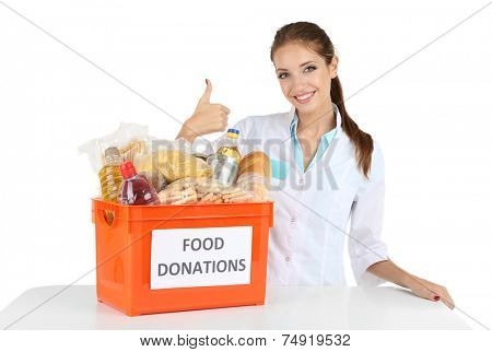 Girl volunteer with donation box with foodstuffs isolated on white