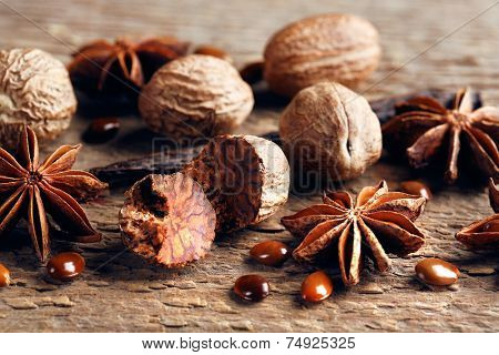 Stars anise with nutmeg on wooden background