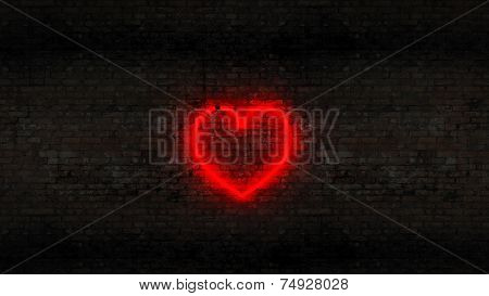 Neon heart on the brick wall