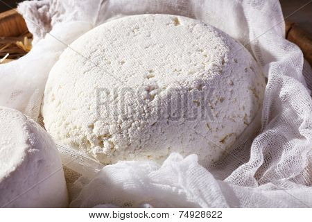 Cottage cheese on gauze in wicker basket closeup