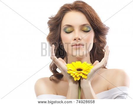 closeup portrait of attractive  caucasian woman brunette isolated on white studio shot lips  face hair head and shoulders skin makeup yellow flower aroma spring summer eyes closed