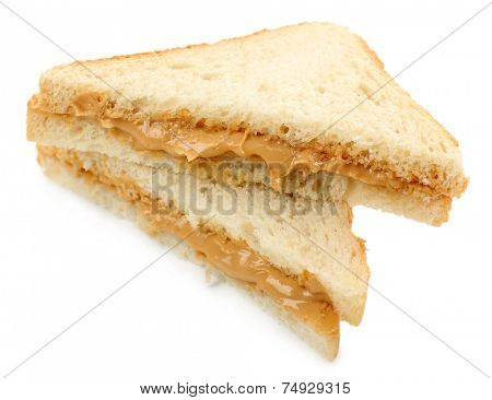 Bread slice with creamy peanut butter, isolated on white