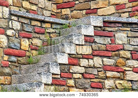 Old White Stone Stairs And Multicolored Stonework Wall