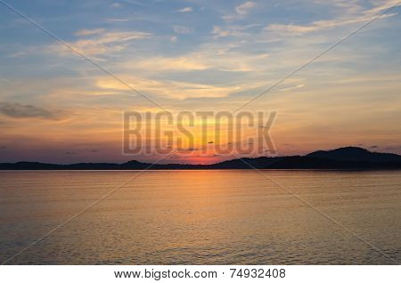 Landscape Of Sea And Sunrise Behind Mountain