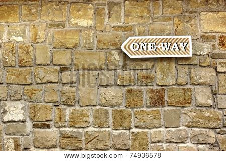 One Way Arrow On Old Stone Wall