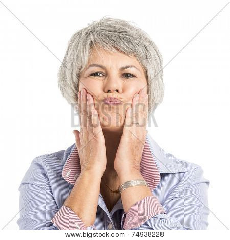 Portrait of a elderly woman making a funny face