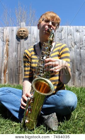 Woman Plays Saxaphone Outdoors