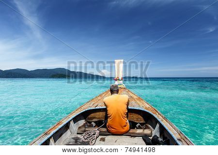 Longtail Boat On Crystal Clear Sea At Tropical Beach