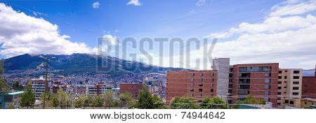 rooftops with Pichincha volcano in the background of Quito Ecuador
