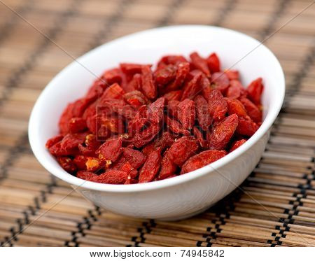 Dehydrated Goji Berries In Bowl On Oriental Mat
