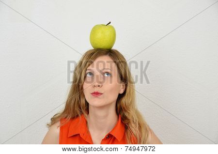 Blonde girl with an apple on the head