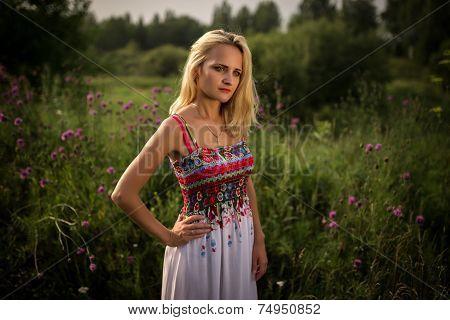 blonde girl in field flowers