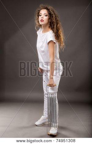 woman doing exercises with expander isolated on gray background