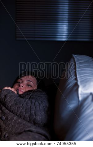 Girl Sleeping On A Couch In Half-light