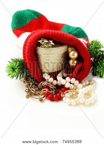 christmas sock with precious gifts (pearl, diamond rings, gold)