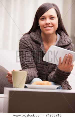Young Businesswoman Having A Working Breakfast