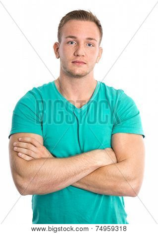 Cool isolated young sportive blond man in green shirt.