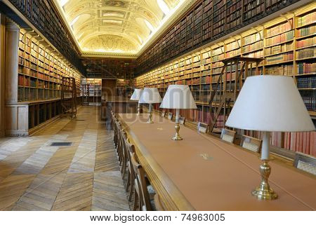 PARIS, FRANCE - SEPTEMBER 14, 2013: Library room of Luxembourg Palace. The palace was originally built in XVII century, and since 1958 it houses the French Senate of the Fifth Republic