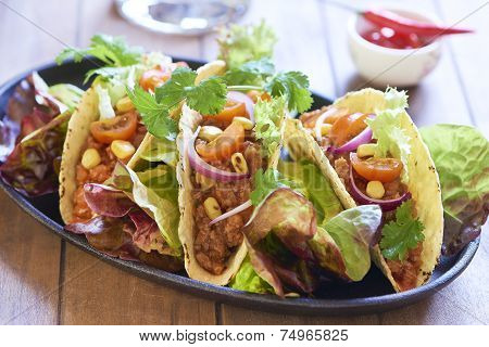 Plate with taco, salad and tomato dip
