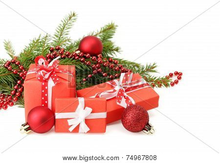 Three gift boxes and Christmas tree branch