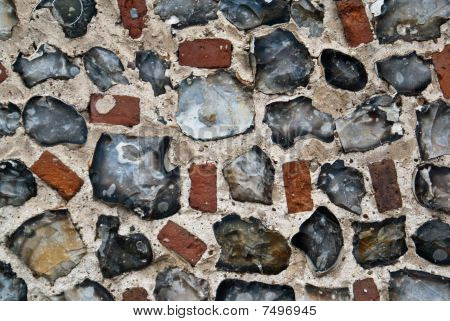 An Exterior Flint Stone And Brick Wall