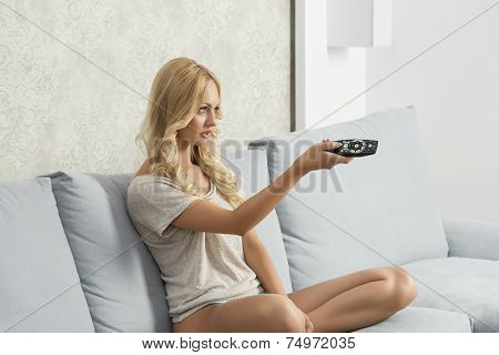 Woman Changing Channel