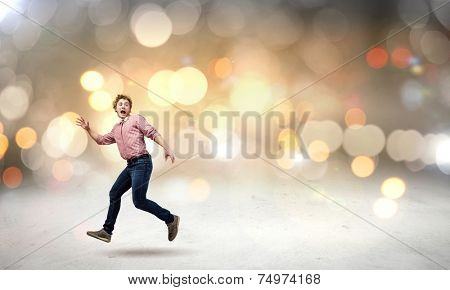 Young man in casual running away from something