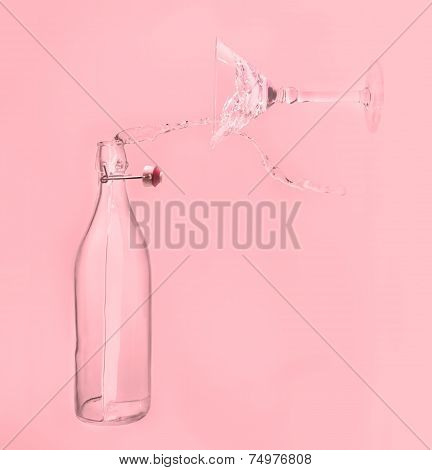 Clear Water Pour Horizontal Out Of Bottle Splash Into Glass With Pink Back Lighting
