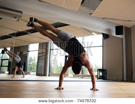 sport, fitness, lifestyle and people concept - man exercising in gym