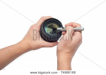 Cropped Image Of Man Cleaning A Camera Lens