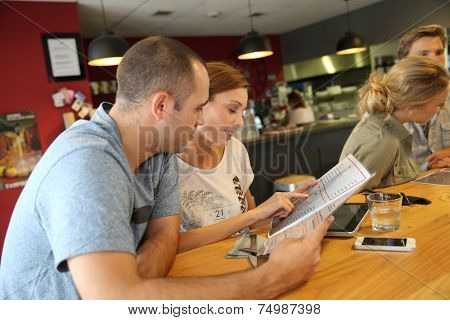 Students at lunch time choosing dish from menu