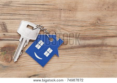 Key chain figure of house and key close up
