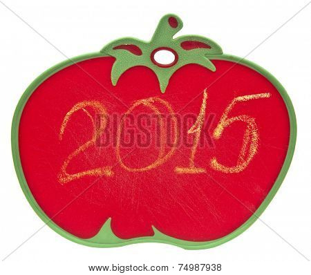 2015 on chalkboard in shape of tomato over white background
