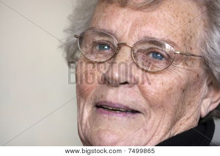 Elderly Woman Gazing And Smiling