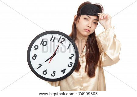 Sleepy Asian Girl With Eye Mask Hold A Clock