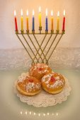 image of hanukkah  - Hanukkah menorah with burning candles and traditional doughnuts