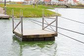 stock photo of raft  - fun ferry raft floats on the water - JPG