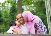 picture of southeast asian  - Happy Southeast Asian Muslim family - JPG