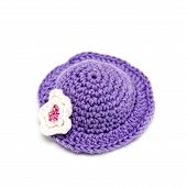 picture of knitted cap  - Knitted cap for a toy on a white background closeup - JPG