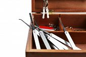 pic of pick-lock  - Set of keys and lock picks in wooden box close - JPG