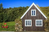 pic of iceland farm  - Traditional Icelandic turf house on a farm - JPG