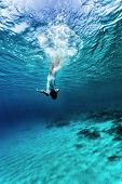 stock photo of rest-in-peace  - Active young female dancing underwater - JPG